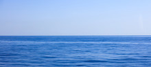A View Of Calm Sea And Blue Sk...