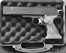 An Automatic Pistol In A Pistol Case.