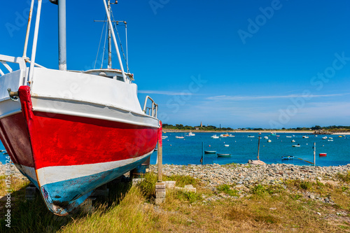 Fishing Boat on Shore in the Village of Vale, Guernsey, Channel Islands, UK on summer day