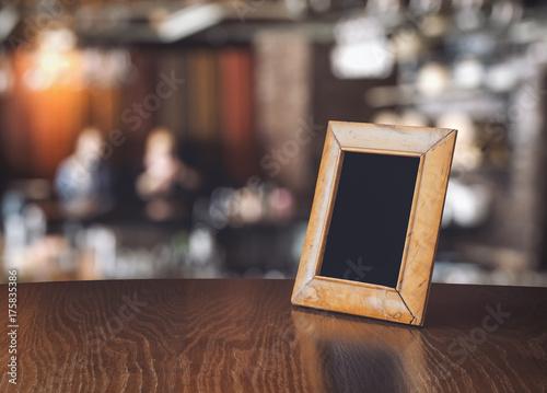 Fototapeta old photo frame on the wooden table obraz na płótnie
