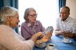 canvas print picture - Smiling senior woman showing cards to friends while playing