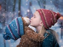 A Little Girl Kisses A Teddy B...