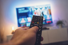 Male Hand Holding TV Remote Co...