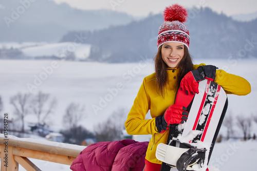 Poster Wintersporten Sport woman snowboarder on snow over winter resort