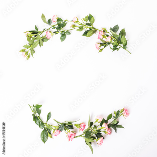 Poster Fleur Flowers composition. Frame made of dried rose flowers on white wooden background. Flat lay, top view