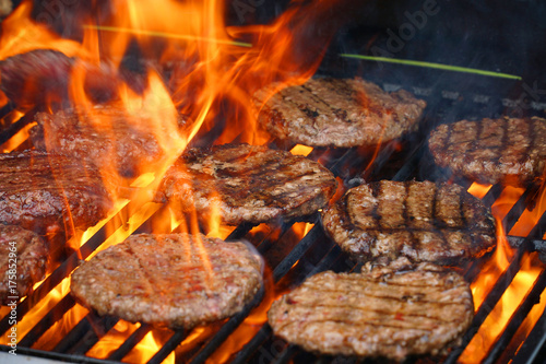 Aluminium Prints Grill / Barbecue barbecue grill cooking burger steak on the fire