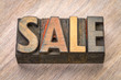 sale word abstract in wood type