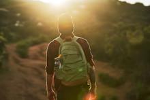 Male Millennial Hiker Trekking...