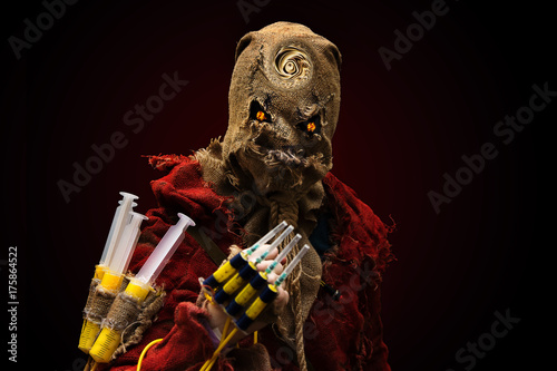 evil demon effigy, syringe in hand. cosplay Canvas Print