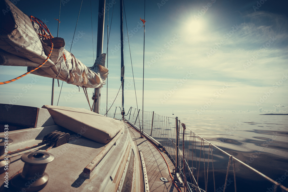 Fototapeta Yachting on sail boat during sunny weather
