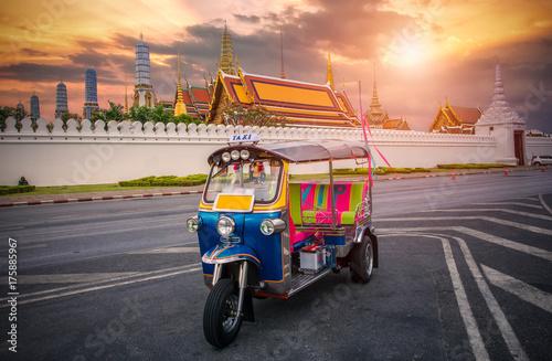 Tuk tuk on the background of Bangkok's Grand Palace Complex and Wat Phra Kaew, o Canvas Print