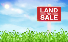 Land Sale Sign On Grass Field With Sky Background