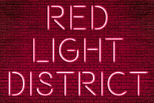 RED LIGHT DISTRICT - Neon Letters Sign Lighting On Brick Wall Background