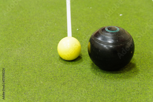 Valokuva  Bowl and jack on an indoor bowls carpet