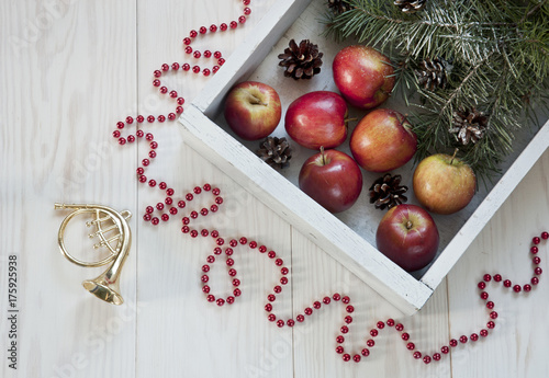 Christmas decor with apples on a white wooden background Canvas Print