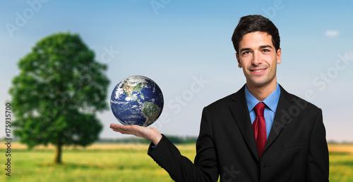 Fototapeta Kierownik trzyma planetę w ręce