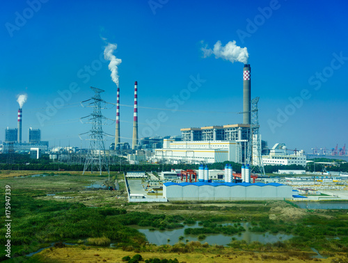 Smoking smokestack of chemical plant with blue sky Canvas Print