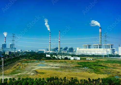 Photo  Smoking smokestack of chemical plant with blue sky