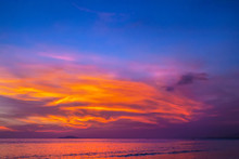 Purple Sunset In Sanya, Hainan, China. Colorful Madness From The Clouds, Merging With The Sea.