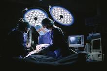 Team Of Surgeons Doing Surgery
