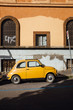 Yellow Fiat 500 Parked in Rome