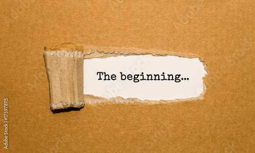The text The beginning appearing behind torn brown paper Canvas Print