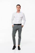 Full Length Portrait Of A Cheerful Young Man
