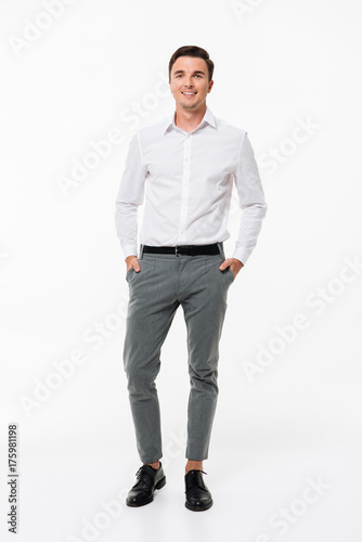 Full length portrait of a cheerful young man Wall mural