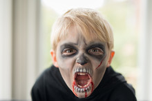 Little Boy With Scary Zombie G...