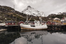 Fishing Boat On A Norway Harbor