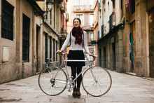 Chic Woman With Her Vintage Bicycle On The Street.