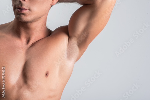 Pleasant nude man is showing his body parts Fototapete