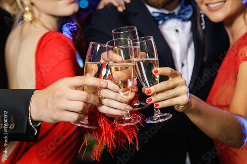Hands with a full glasses of sparkling wine