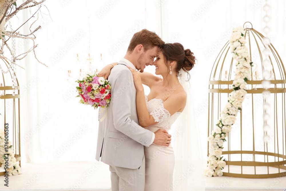 Fototapeta Happy beautiful couple on wedding day, indoors