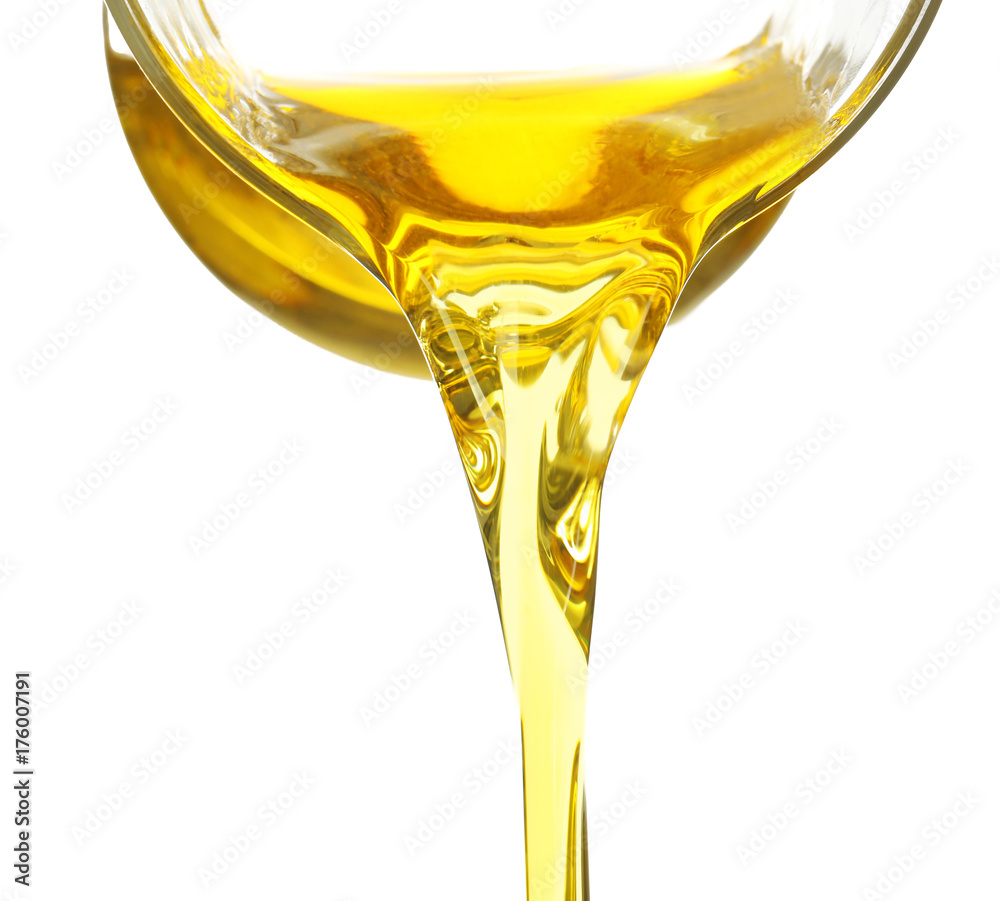 Fototapety, obrazy: Pouring cooking oil from glass jug on white background, closeup