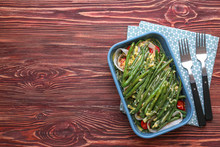 Baking Dish With Yummy Green Bean Casserole On Wooden Table