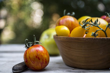 Different Varieties Of Tomatoes In Wooden Bowl