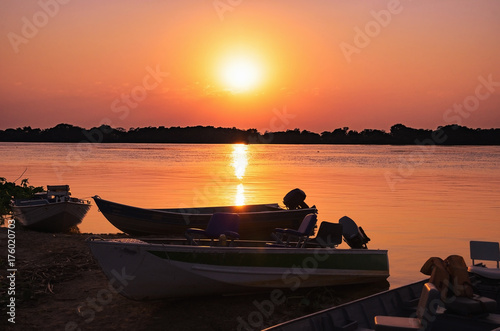 Fotografie, Obraz  Wonderful landscape of a silhouette of boats on a amazing sunset