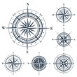 Set of isolated compass roses or windroses isolated on white. Raster illustration.