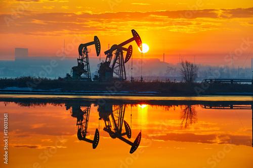 Fototapeta The sunrise of oil field landscape obraz
