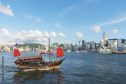 Junk Ship in Victoria Harbor of Hong Kong city Poster