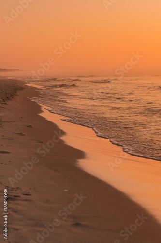 Spoed Foto op Canvas Zee zonsondergang Waving sea during sunset