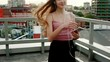 Music, technologies, VR, people, 4k and lifestyle concept - Girl listening music from smart phone mp3 player. at the sunny city streets and chatting with friends, sunset background. Slow motion