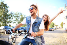 Happy Funny Young Couple Ridin...
