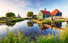 Traditional Dutch Windmill Near The Canal. Netherlands, Landcape At Sunset