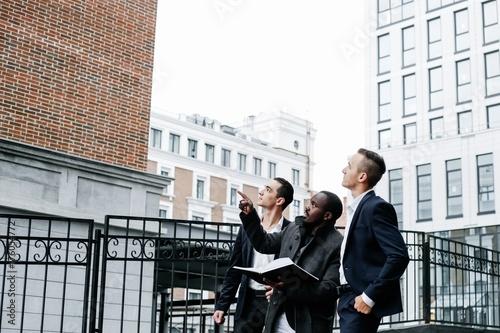 Fotografie, Tablou Three businessmen visiting the construction site