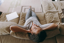 Young Woman At Home Lying On T...