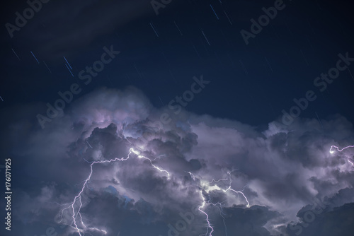 Poster Onweer Lightning in storm cloud, Star on the sky