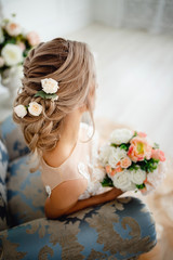 Naklejka Hairstyle with fresh flowers. rear view close-up. Rustic style