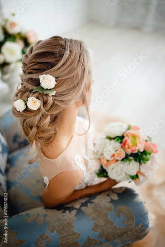 Hairstyle with fresh flowers. rear view close-up. Rustic style